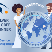 The IT World Award badge is held by a woman and a man